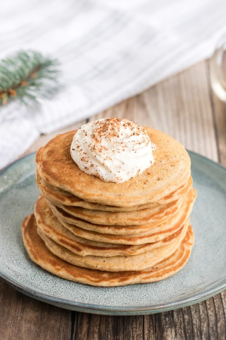 Eggnog pancakes stacked high on plate