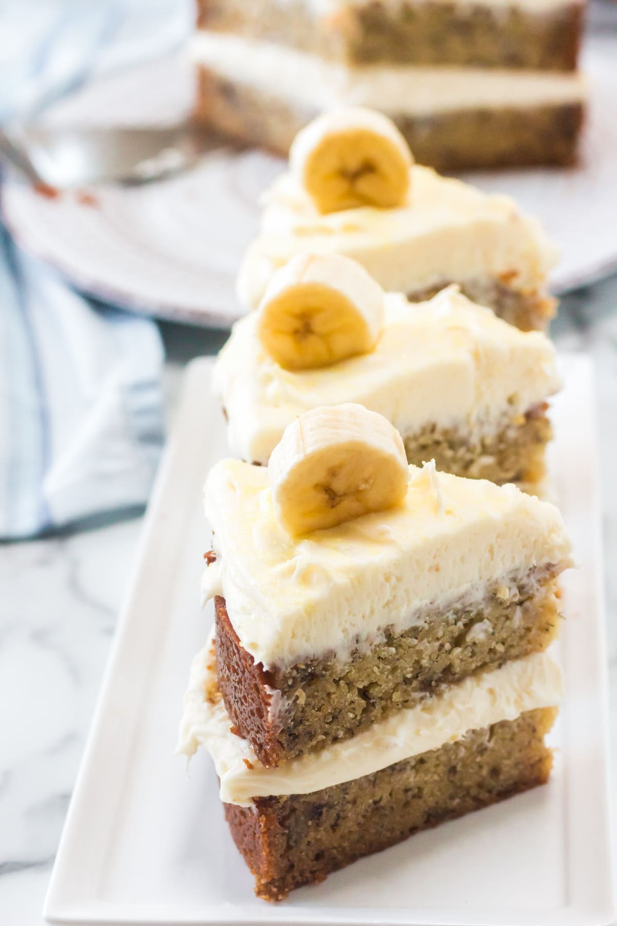 Banana cream cake slices on a plate