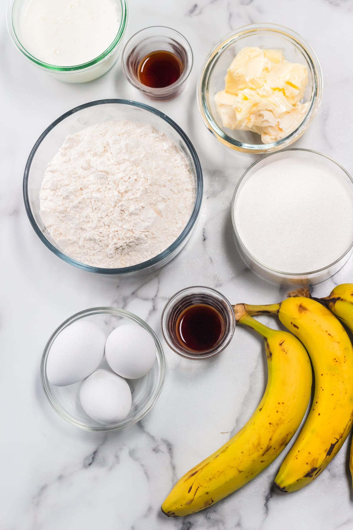 Banana cream cake ingredients laid out on table.