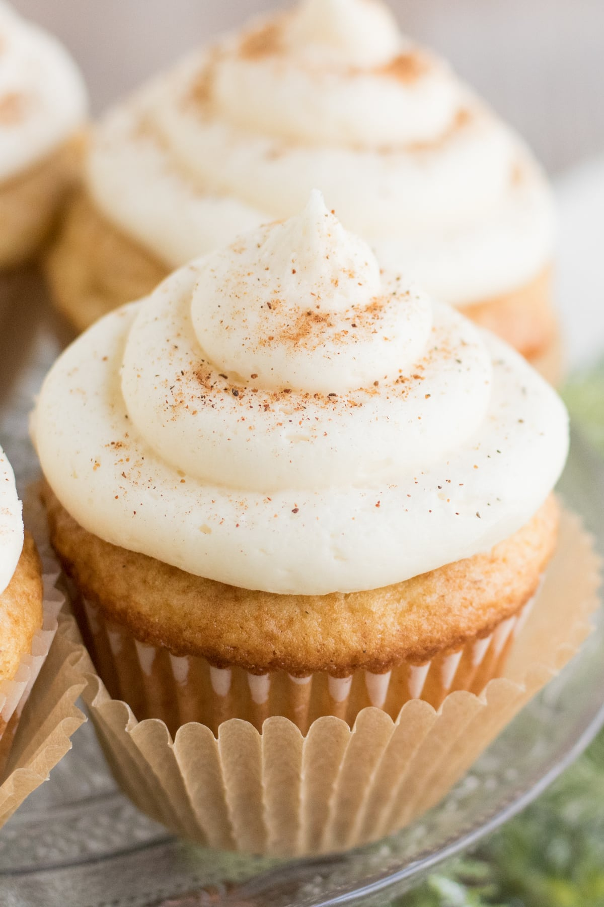 Eggnog cupcakes on a glass plate