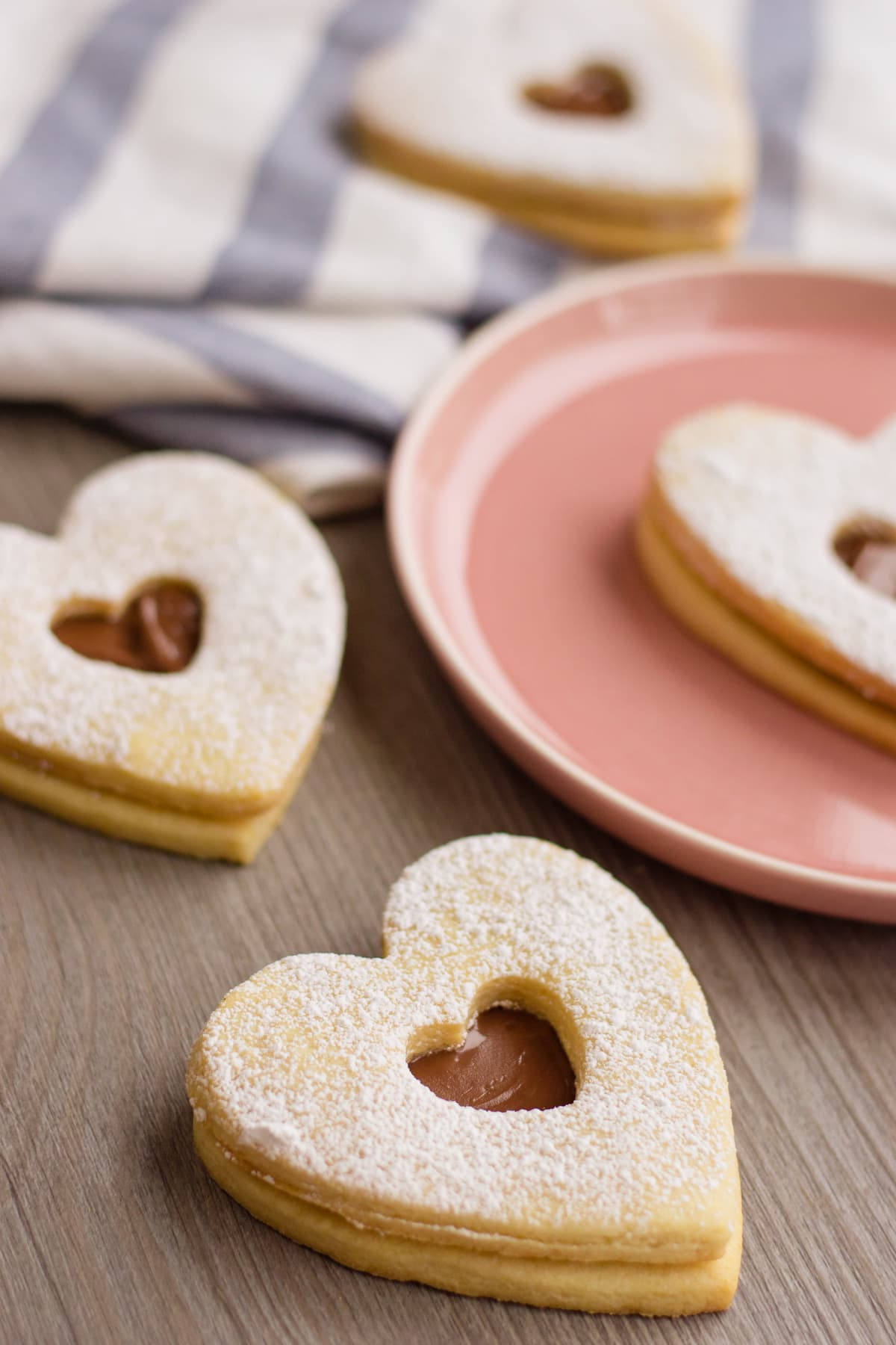nutella filled heart shaped cookies on a table