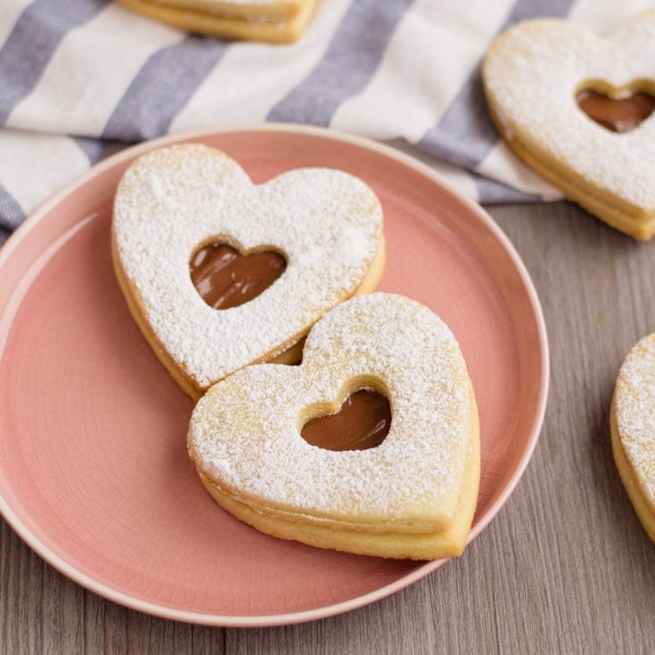 nutella filled sweeheart cookies for valentines day on a plate